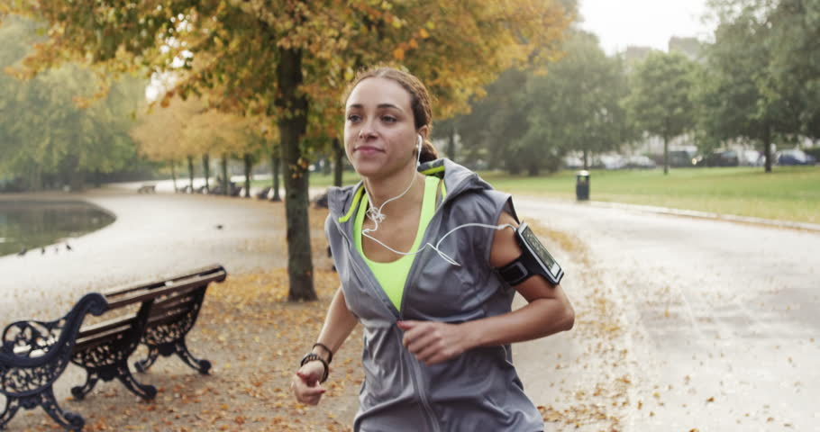 Runner woman running in park exercising outdoors fitness tracker wearable technology #7455685