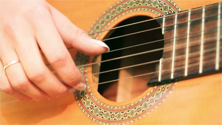 Woman hands touching guitar chords, steadycam shot