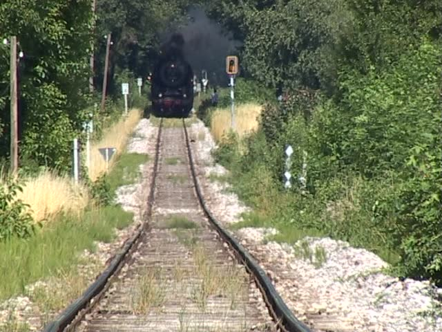 Historic steam train coming straight at the camera. (camera locked down - original ambient sound)