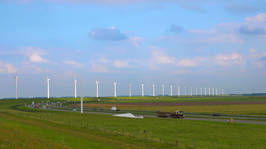 4K DNetherlands landscape with highway traffic and turbine towers rotating | Shutterstock HD Video #7472545