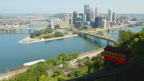 The Duquesne Incline descends Mt. Washington with a view of downtown Pittsburgh, Pennsylvania, at the confluence of the Allegheny and Monongahela Rivers, in the background.