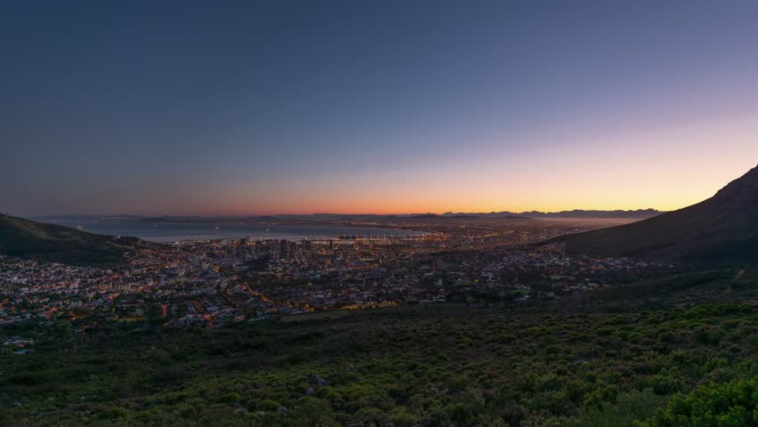 4K Timelapse 4096x2304 UHD of Cape Town city from Table Mountain as the sun rises, from night to day at sunrise. Holy grail time lapse shot in Cape Town South Africa