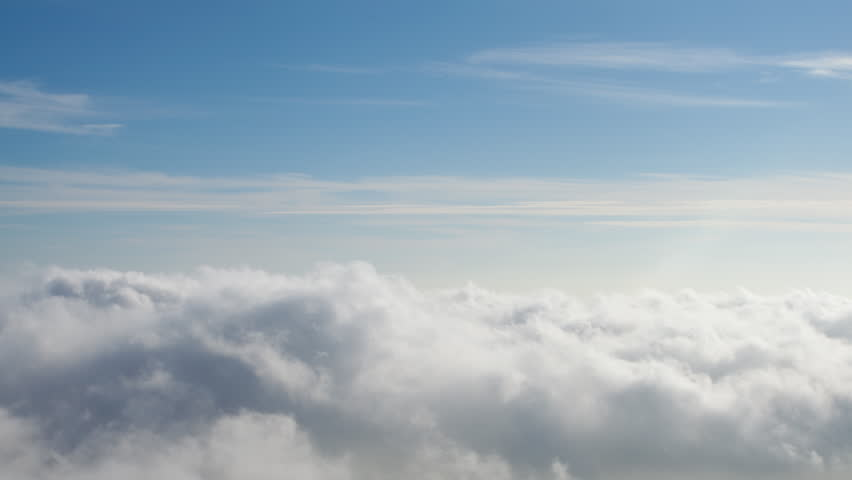4K time lapse of blue sky above swirling puffy inversion clouds on a sunny afternoon