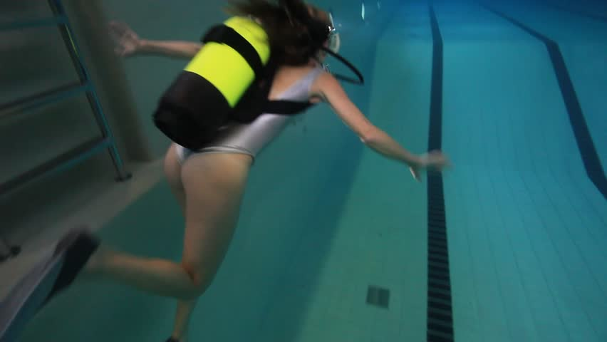 Woman Underwater With Silver Swimsuit And Mask In The Pool ...