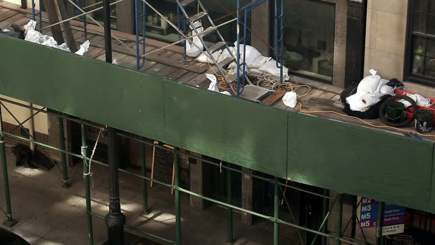 NEW YORK - SEPT 15, 2014: construction laborers climbing scaffolding in Manhattan, New York City. Workers are required to wear safety gear on job site at all times. | Shutterstock HD Video #7570645