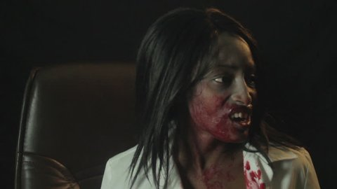 Vampire Girl Loses Her Mind Laughing Covered in Blood. Vampire girl losing her mind, laughing, really starting to enjoy the vampire thing. Camera pans right. Shot flat.