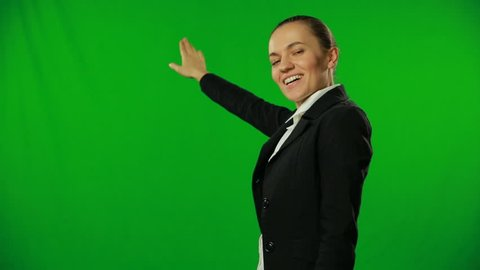 Weather girl is giving forecast on a green screen.FULL HD.