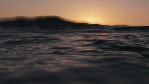 Sea surface from underwater at sunset in slow-motion. Shot on RED Cinema Camera in 4K, crop, rotate and zoom easily. H264 codec High bit rate.