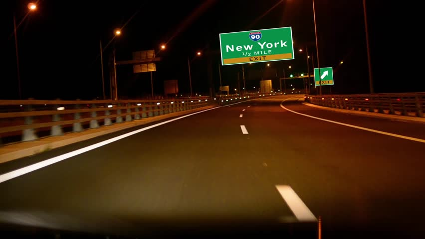 Driving on Highway/interstate at night,  Exit sign of the City Of New York, New York
