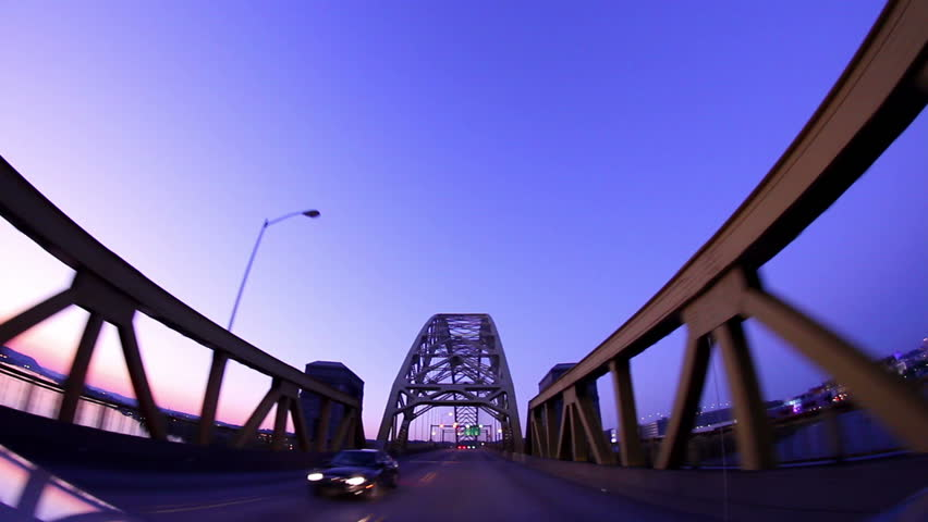 Traveling over the West End Bridge at dusk in Pittsburgh PA.  Fisheye lens.