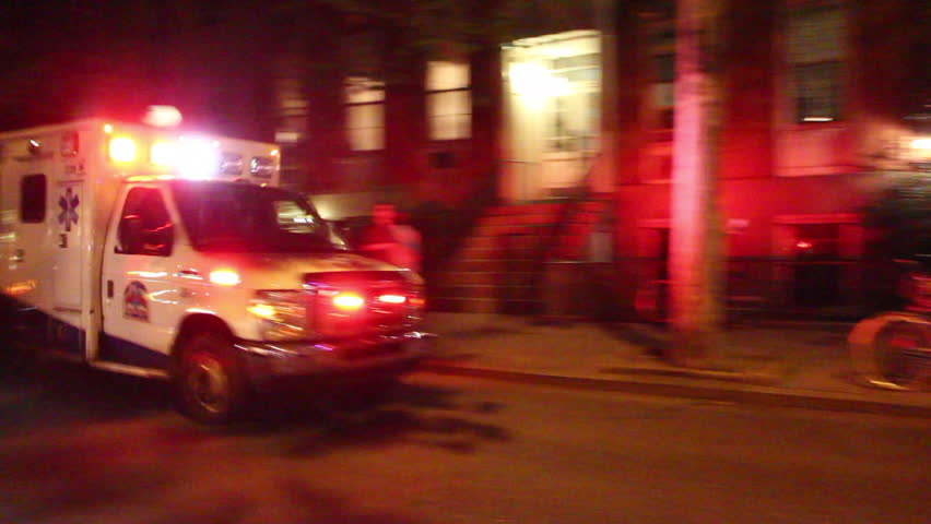 NEW YORK - AUGUST 9: Ambulance with siren at night shot on August 9, 2012 in New York, NY.