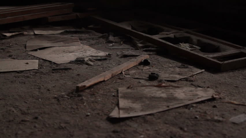 Dolly shot of dirt and paper on floor in abandoned haunting house | Shutterstock HD Video #7657480