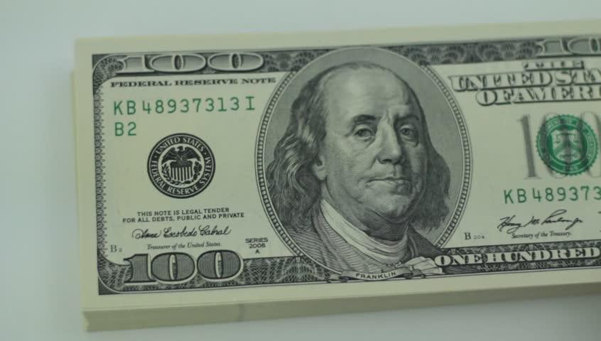 Stack of one hundred dollars bills | Shutterstock HD Video #7663885