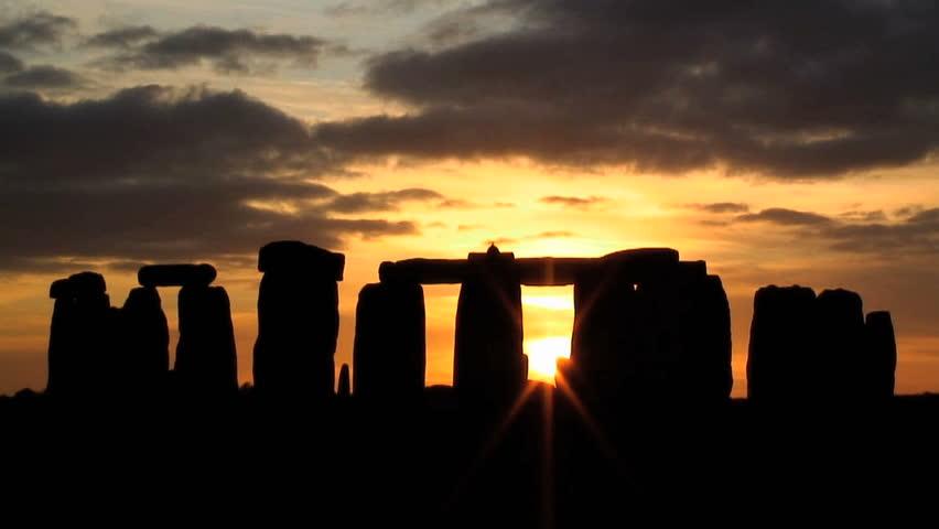Time lapse Silhouette Sunset over Stonehenge Wiltshire England UK
