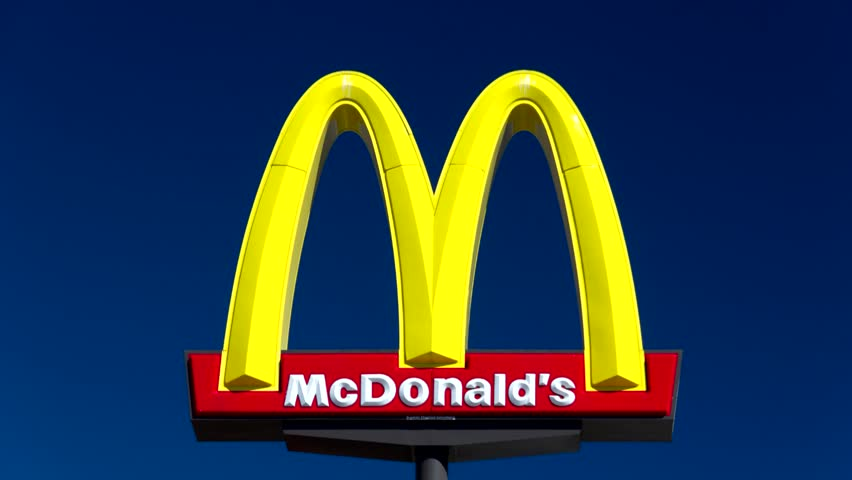VALENICA, CA/USA - AUGUST 5, 2014: McDonald's restaurant sign. The McDonald's Corporation is the world's largest chain of hamburger fast food restaurants.