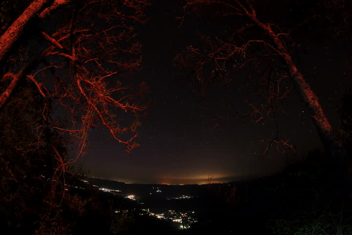 Loop animation of an illuminated world map a network of lines 6k time lapse of the night sky with clouds and stars passing by behind mountain sciox Image collections