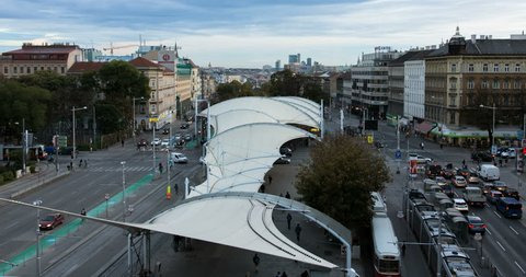 On the rooftop of the viennese library one has a great view over the city. Around the place urban traffic is going on.