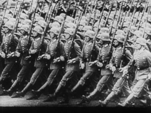 GERMANY - 1930s: World War II, German soldiers marching, Hitler in staff car in a parade, Hitler enters government building
