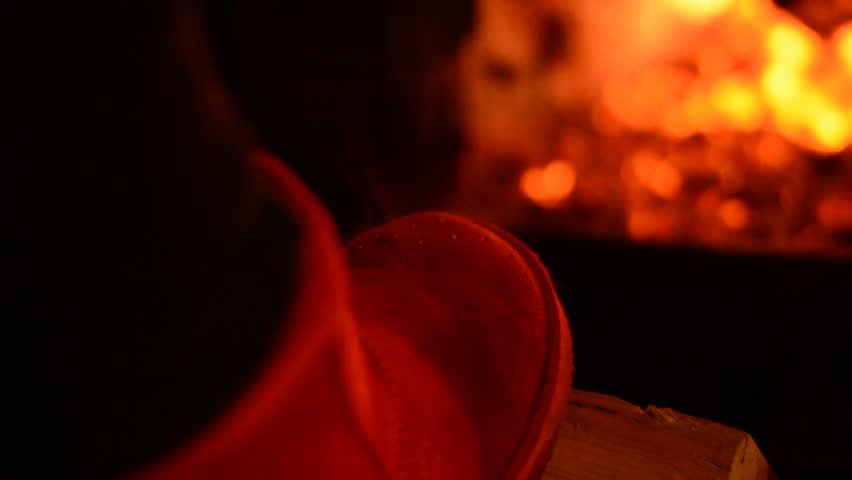 steam rises from the shoes near the fireplace