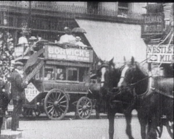 EUROPE- CIRCA 1900-1910: Horse-drawn vehicles and the first cars.