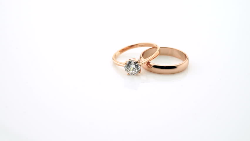 Rose Gold Wedding Rings Turning On White Background With Copy E Hd Stock Footage Clip