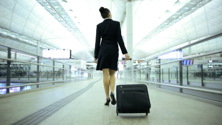 Young Caucasian European smart suit female business traveller airport terminal atrium conference meeting professional corporate management | Shutterstock HD Video #7810105