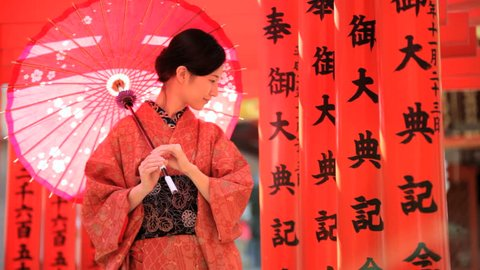 Japan Asian Japanese national culture Buddhist temple red kimono parasol traditional costume tourism travel investment business