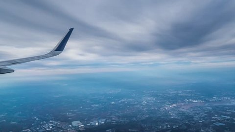 Jet plane taking off from JFK airport, flying over Manhattan, New York City. Window view with wing. 4K UHD Timelapse.