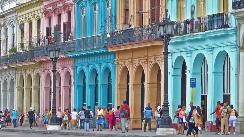 HAVANA, CUBA - OCTOBER 8, 2014: Old classic American cars on the streets of  Havana city, Cuba.Urban scene, people and traffic