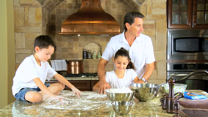 Home Kitchen Cooking attractive caucasian mother & children cooking together in their