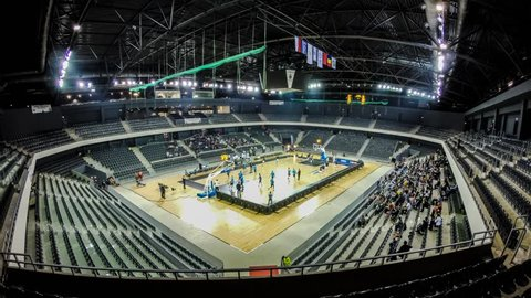 CLUJ NAPOCA, ROMANIA - November 11: Time lapse of Cluj indoor arena seats filling up with crowd of basketball fans, at a U Mobitelco vs Trabzonspor Medical Park match.On Nov 11, 2014 in Cluj, Romania