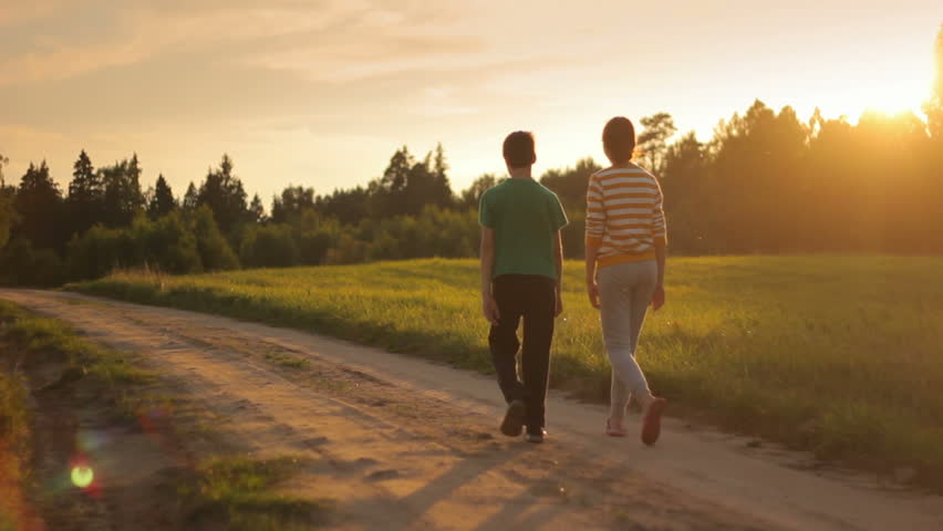 Image result for two persons holding hands and walking down the road