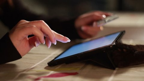 Tablet tracking shot at home while paying with credit card. Find similar in our portfolio.