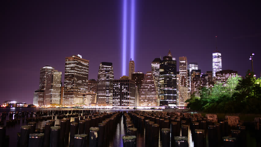 lower manhattan skyline and light memorial towers 4k time lapse from new york