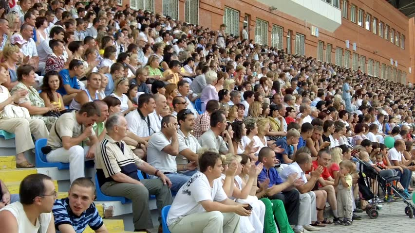 SUMY, UKRAINE - JUNE 28: The audience applauded in the stands at a football match 28, 2010 in Sumy, Ukraine