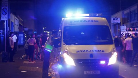 BRISTOL - July 6: Ambulance in Crowd at St Pauls Carnival - July 6 2013 in Bristol England