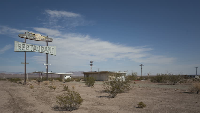 4K Time lapse of abandoned vintage restaurant and sign on historic Route 66, California, USA