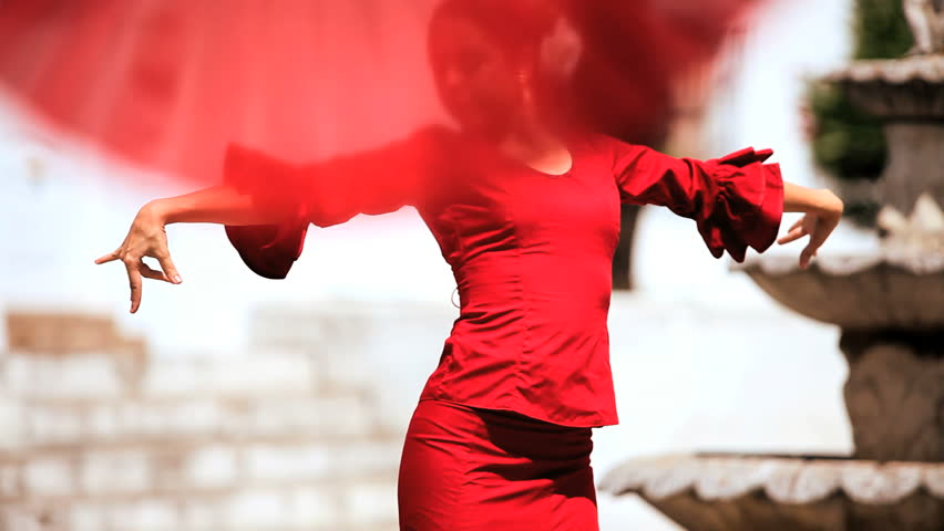Two ladies dancing traditional flamenco in town square in Seville, Spain