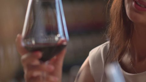 Stock video footage restaurant girls clink glasses red wine