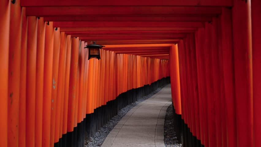 Kyoto, Japan at Fushimi Inari Shrine's fame torii gates.