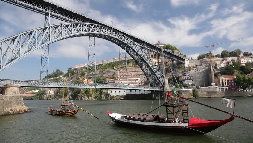 PORTO - JULY 03: Famous Dom Luis Bridge that spans the Douro River between the cities of Porto and Vila Nova de Gaia in Portugal.