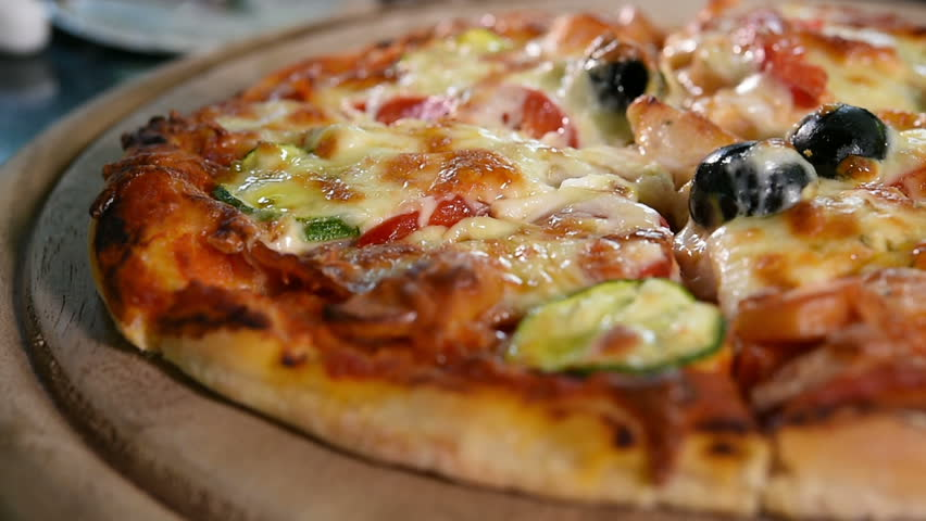 Close up of pizza on wooden board.    Shutterstock HD Video #8140315