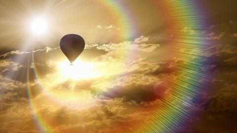 Hot air balloon traveling through spectrum of colorful rays at sunset.