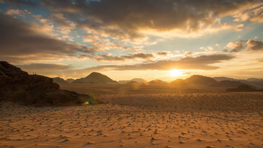 Sunset in Wadi Rum desert, Jordan, Middle East, Asia - establishing time-lapse 4K video footage