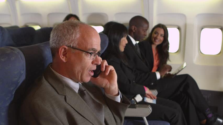 Business passenger on cellphone | Shutterstock HD Video #8191090