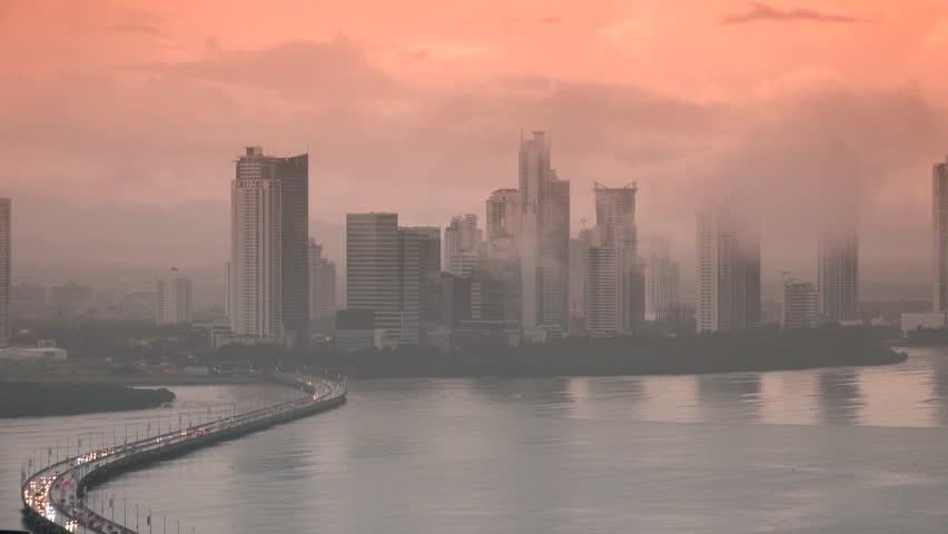 Central America and emerging Countries with skyline view of Costa del Este in Panama City and traffic on highway at sunset. 4K, Ultra HD, UltraHD, UHD | Shutterstock HD Video #8205685