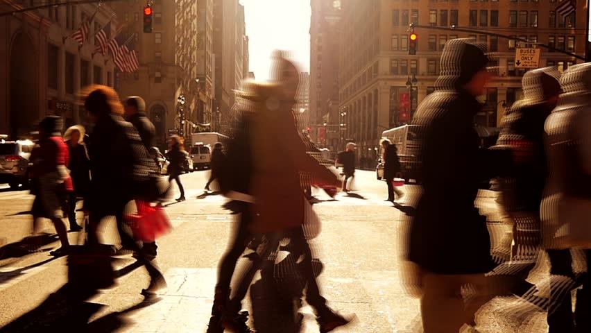 people walking over crosswalk in new york city. pedestrians background