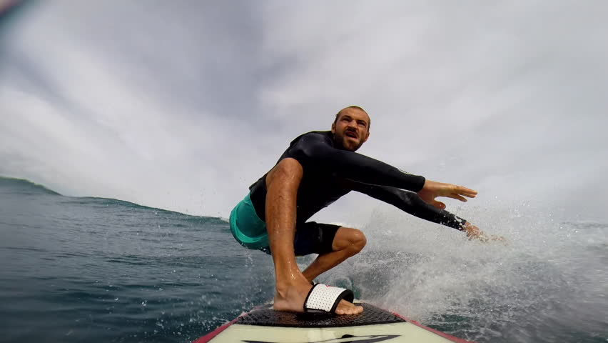 A surfer riding on small waves, maintains balance while riding, POV   Shutterstock HD Video #8258695
