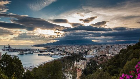 Sunset with clouds at Malaga harbour, Spain. Day to Night timelapse
