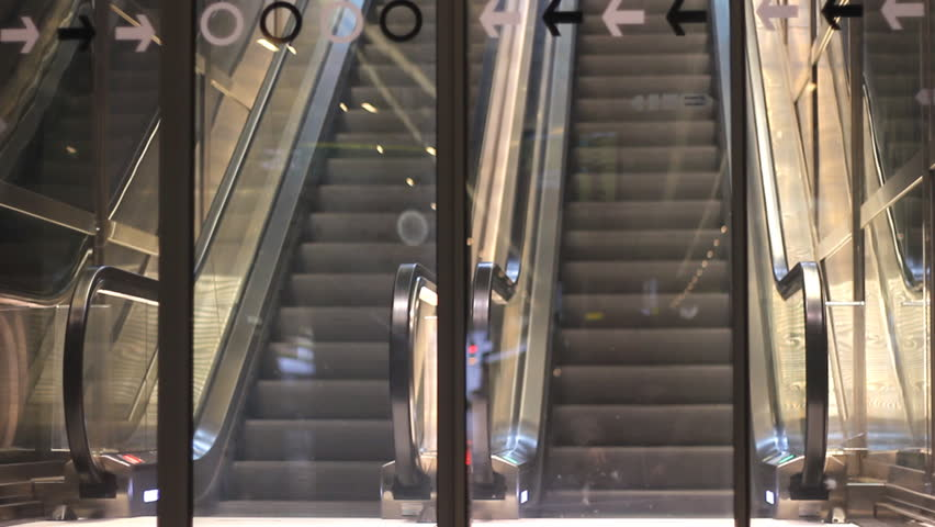 Malmo,Sweden December 18 2014 :Underground Moving stairs in Modern metro Station  traveling through  Station 1920x1080 full hd footage | Shutterstock HD Video #8290165
